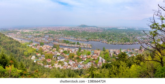 Beautiful aerial view cityscape of Houseboat in Dal Lake is famous place the main attractions at Srinagar, Jammu and Kashmir, India. Srinagar is several places called the Venice of the East