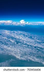 Beautiful aerial view of Cumulonimbus clouds taken from airplane.