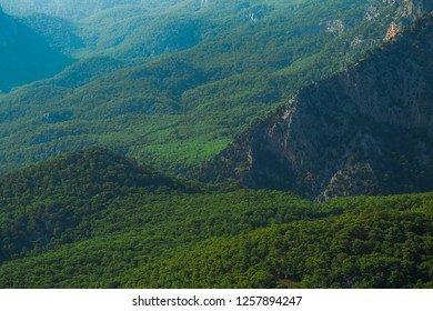 Beautiful aerial view at green woody hills of mountains in Turkey. Hills with thick wood growing. Horizontal color photography.