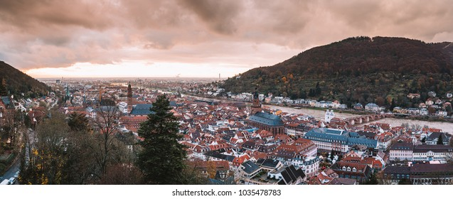 Beautiful aerial view of the Heidelberg old town in Germany during orange sunset.