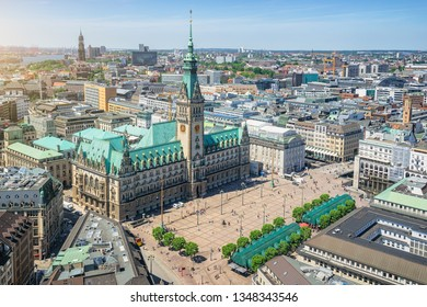 Beautiful aerial view of historic city center of hanseatic Hamburg with famous town hall at market square and ancient harbour district in the background on a sunny day with blue sky in summer, Germany