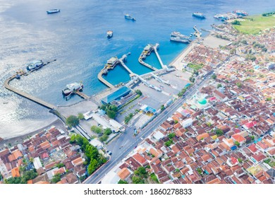 Beautiful aerial view of Ketapang harbor with ferry boats on turquoise water in Banyuwangi, East Java. Indonesia