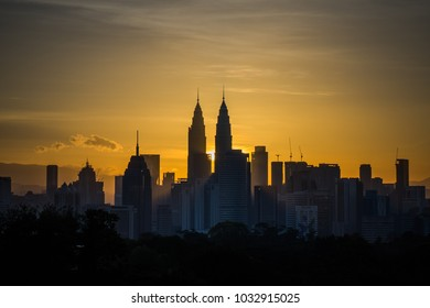 Beautiful aerial view Kuala Lumpur city in the morning with dramatic sky, clouds and sun rays.