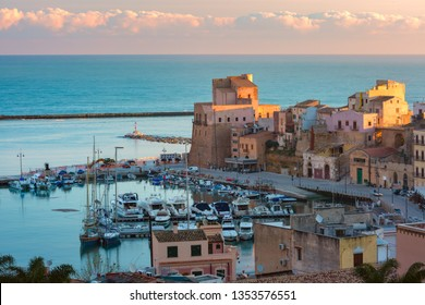 Beautiful aerial view of medieval fortress in Cala Marina, harbor in coastal city Castellammare del Golfo at sunset, Sicily, Italy