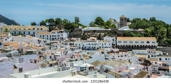 Beautiful aerial view of Mijas - Spanish hill town overlooking the Costa del Sol, not far from Malaga. Mijas Plaza de Toros on the background. Mijas, Andalusia, Spain.