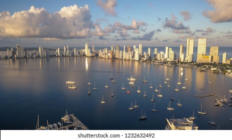 A beautiful Aerial View of the modern Skyline of Cartagena de Indias in Colombia on the Caribbean coast of South America during sunrise. Many Sailboats anchoring next to Yacht Club in Cartagena Bay.