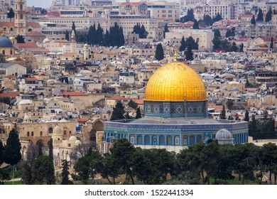 Beautiful Aerial view of the Old City and Dome of the Rock during a sunny and cloudy day. Taken in Jerusalem, Capital of Israel.