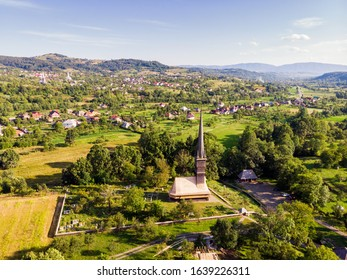 Beautiful aerial view on the Church of the Archangels Michael and Gabriel in Surdesti, Maramures County near Baia Mare, Romania. Traditional Maramures wooden architecture. UNESCO world heritage site.