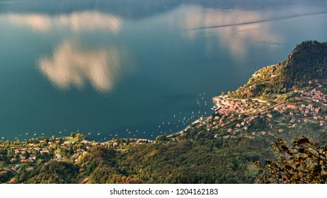 beautiful aerial view on the Maggiore Lake in autumn season with clouds reflected on the water