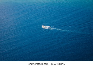 Beautiful aerial view on ocean with white boat