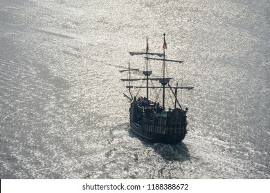 Beautiful aerial view on vintage pirate caravel on sunlit sea water. Scenic travel concept.