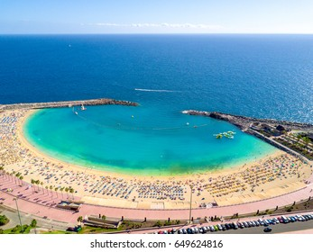 Beautiful aerial view of Playa de Amadores beach on the Gran Canaria island in Spain. Gorgeous sea shore of the Canary islands.