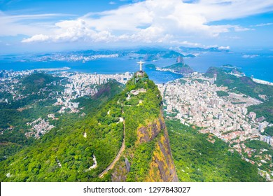 Beautiful aerial view of Rio de Janeiro city with Christ the Redeemer in Corcovado and Sugarloaf Mountain in the background from the helicopter ride - Rio de Janeiro, Brazil