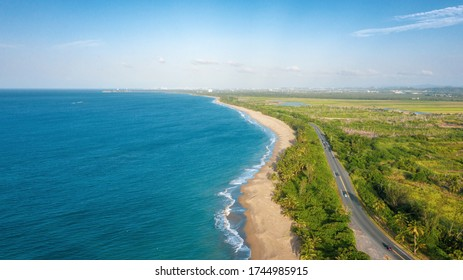 A beautiful aerial view of a road and the coast of Dorado, Puerto Rico