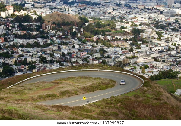 Beautiful aerial view of the San Francisco Twin Peaks overlooking the city's scenic skyline with numerous buildings and landmarks in the background - California, USA