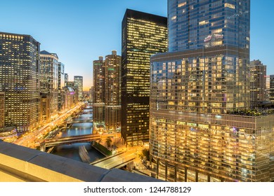 Beautiful aerial view of skyline along Chicago river through downtown at blue hour evening
