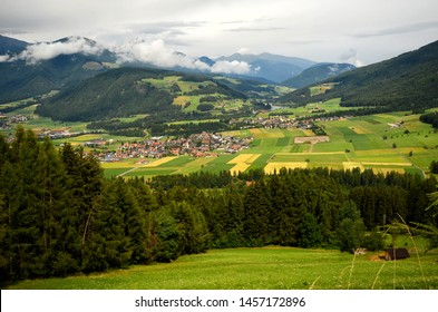 Beautiful aerial view of Valdaora (Olang) near Brunico (BZ) as seen from the road for Passo Furcia. South Tyrol, Italy.