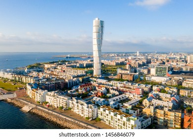 Beautiful aerial view of the Vastra Hamnen (The Western Harbour) district in Malmo, Sweden, during sunset. View from above.