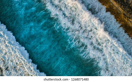 Beautiful aerial view of the waves along the coastline of the Maldives