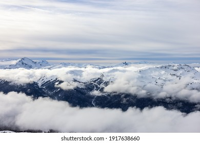 Beautiful Aerial View of Whistler Mountain during a sunny winter day. Taken from Blackcomb Peak, Whistler, British Columbia, Canada. Canadian Nature Landscape
