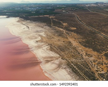 Beautiful aerial wide vibrant summer view of las Salinas de Torrevieja, The Pink Lake Of Torrevieja, pink salt lagoon in Torrevieja, Costa Blanca, province of Alicante, Spain