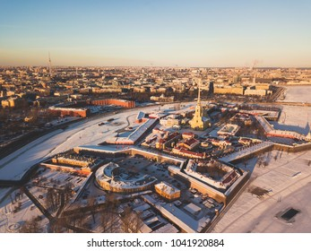 Beautiful aerial winter sunny view of Saint-Petersburg, Russia, Peter and Paul Fortress with cityscape and scenery beyond the city, shot from drone