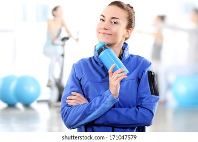 Beautiful aerobics trainer .Athletic woman in the gym