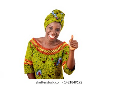 beautiful african adult woman dressed in loincloth and green scarf is happy showing thumbs up with hand