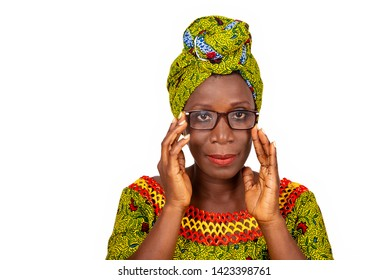 beautiful african adult woman dressed in loincloth and green headscarf wearing beautiful glasses to the eyes is smiling