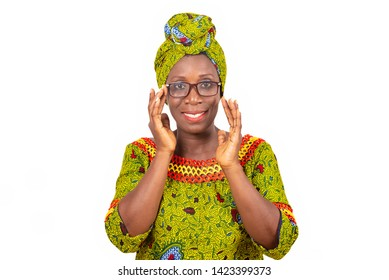 beautiful african adult woman dressed in green loincloth wearing beautiful glasses with eyes smiling
