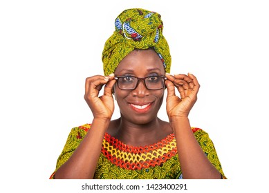 beautiful african adult woman dressed in green loincloth is wearing beautiful glasses with eyes smiling