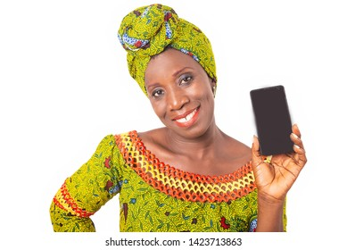beautiful african adult woman dressed in green loincloth is smiling showing a mobile phone
