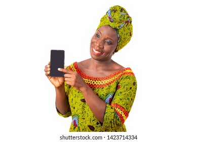 beautiful african adult woman dressed in loincloth and green scarf is happy showing her phone