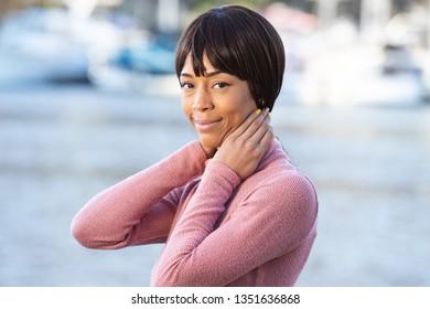 Beautiful African American with black hair bangs outside near la