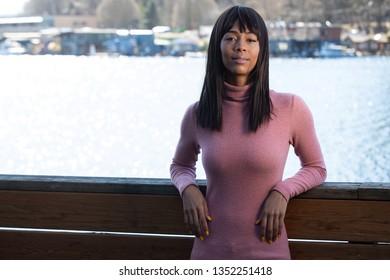 Beautiful African American with black hair bangs outside near lake