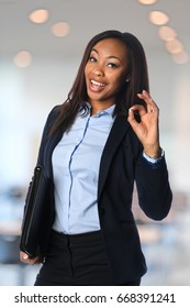Beautiful African American businesswoman giving the OK sign