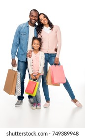 beautiful african american family holding shopping bags and smiling at camera isolated on white