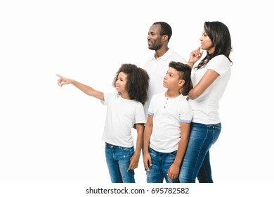 beautiful african american family with two kids pointing away isolated on white