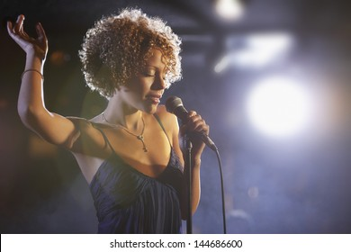 Beautiful African American female jazz singer on stage