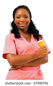 Beautiful African American female medical professional in scrubs - smiling holding pill bottle