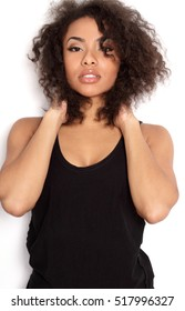 Beautiful African American girl with afro on white background