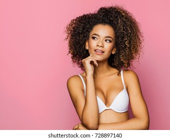 Beautiful african american girl with an afro hairstyle thinking