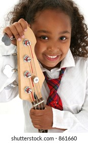 Beautiful African American girl holding a bass guitar.