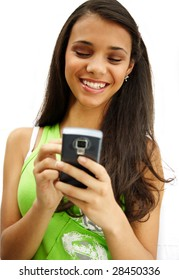 Beautiful african american girl smiling with her cellphone.