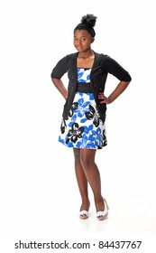 Beautiful African American Haitian teen girl wearing a dress, sweater and heels with her hair up.  Posing and smiling on a white background.  Space for copy.