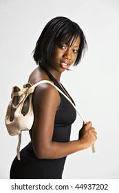 Beautiful African American Teen with Ballet Shoes.