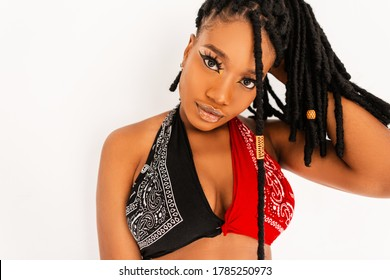 Beautiful African American woman with beauty makeup with amazing eyes with clean skin with stylish dreadlocks in fashion red-black swag top bandana straightens hair on white background. Sexy afro girl
