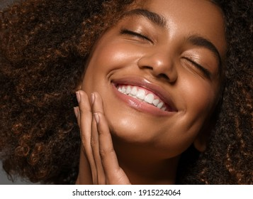 Beautiful african american woman face close up  teeth smile happy positive