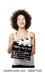 Beautiful african american woman laughing and holding a clapboard, isolated on white