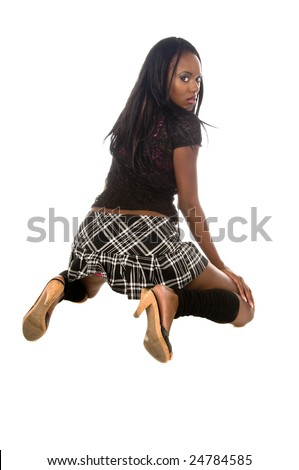 Beautiful African American Woman In A Naughty School Girl Outfit On Her Knees And Looking Back
